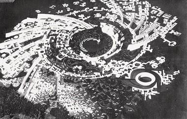 История Ауровиля: модель «Галактика» 1968г., со скульптурой пламени в центремодель «Галактика» 1968г., со скульптурой пламени в центре